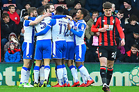 Wigan Athletic players celebrate the goal scored by Will Grigg of Wigan Athletic as Connor Mahoney of AFC Bournemouth looks dejected during AFC Bournemouth vs Wigan Athletic, Emirates FA Cup Football at the Vitality Stadium on 6th January 2018