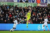 Carl Dickinson of Notts County (C) heads the ball back during The Emirates FA Cup match between Swansea City and Notts County at The Liberty Stadium, Swansea, Wales, UK. Tuesday 06 February 2018