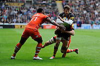 Elliot Daly of Wasps is tackled by Vereniki Goneva and Julian Salvi of Leicester Tigers