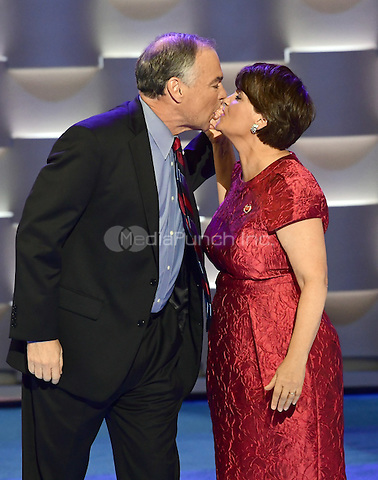 United States Senator Tim Kaine (Democrat of Virginia) kisses his wife, Anne, after completing his remarks accepting the Democratic Party nomination for Vice President of the US during the third session of the 2016 Democratic National Convention at the Wells Fargo Center in Philadelphia, Pennsylvania on Wednesday, July 27, 2016.<br /> Credit: Ron Sachs / CNP/MediaPunch<br /> (RESTRICTION: NO New York or New Jersey Newspapers or newspapers within a 75 mile radius of New York City)