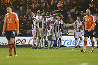 Billy Waters of Cheltenham Town celebrates with team mates after he scores his team's third goal of the game to make the score 1-3 during the Sky Bet League 2 match between Luton Town and Cheltenham Town at Kenilworth Road, Luton, England on 31 January 2017. Photo by David Horn / PRiME Media Images