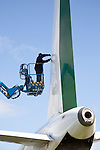 Man repairing plane Cotswold Airport, Cirencester, Gloucestershire, England, UK