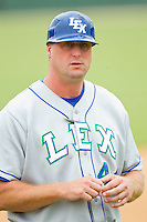Lexington Legends manager Brian Buchanan (44) coaches third base during the South Atlantic League game against the Kannapolis Intimidators at CMC-Northeast Stadium on July 31, 2013 in Kannapolis, North Carolina.  The Intimidators defeated the Legends 3-2.  (Brian Westerholt/Four Seam Images)