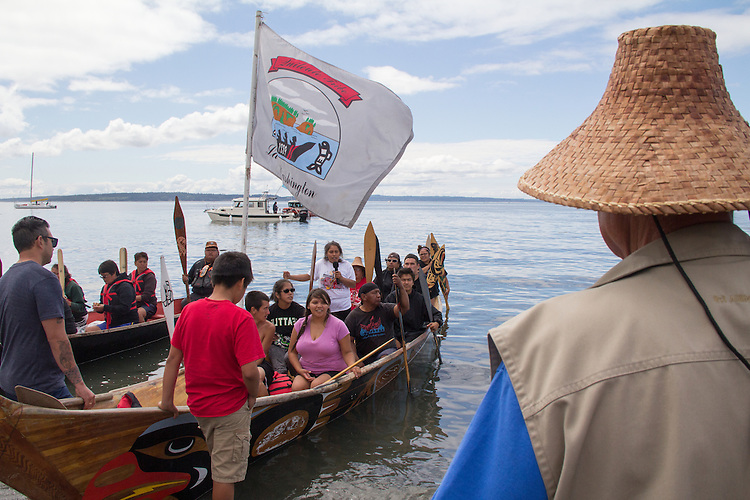Canoe Journey, Paddle to Nisqually, 2016, Marlin Holden, Executive Director of the Jamestown S'Kallam Tribe welcomes Quinault, La Push caones landing, Port Townsend, Fort Worden, en route to Olympia, Washington State, Olympic Peninsula, Puget Sound, Salish Sea, USA,