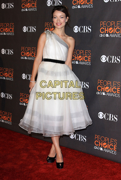 OLIVIA WILDE.Arrivals at the 2010 People's Choice Awards held at the Nokia Theater L.A. Live in Los Angeles, California, USA. .January 6th, 2010 .full length white cream beige grey gray sheer one shoulder pearls beads beaded tulle black peep toe shoes clutch bag hand on hip .CAP/ADM/KB.©Kevan Brooks/AdMedia/Capital Pictures.