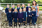Coolick NS new pupils enjoying their first day at school with their teacher Fiona O'Donoghue on Monday were Nathan Herlihy, Rachel O'Sullivan, Orla Doolan, Laura McAlister, Morrie O'Shea  and Alex Coleman Clifford Back row: Hugh O'Callaghan, Alana Lyne, Niamh McCarthy, Kate Ahern, Ryan Leane