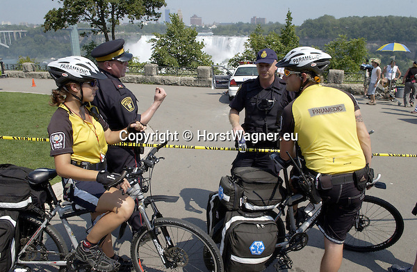 Niagara Falls, Ontario, Canada - 01 August 2006---Paramedics on their bikes with officers of the Niagara Parks Police, in a public park along the river---people, transport---Photo: © HorstWagner.eu