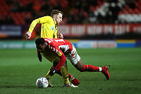 Stephen Quinn of Burton Albion fouls Charlton's Tariqe Fosu during Charlton Athletic vs Burton Albion, Sky Bet EFL League 1 Football at The Valley on 12th March 2019