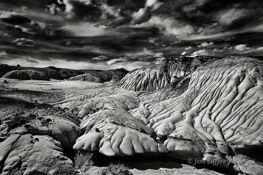 A black and white image of eroded sandstone and clay hills in the Ah Shi Sle Pah Wilderness Study Area in the San Juan Basin of northwestern New Mexico.