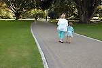 Mother and daughter walking on path through the Christchurch Botanic Gardens