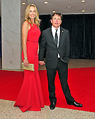 Michael J. Fox and his wife, Tracy Pollan, arrive for the 2013 White House Correspondents Association Annual Dinner at the Washington Hilton Hotel on Saturday, April 27, 2013..Credit: Ron Sachs / CNP.(RESTRICTION: NO New York or New Jersey Newspapers or newspapers within a 75 mile radius of New York City)