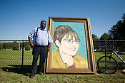 Rodney Hall, an Artist from Beulavile, NC stands next to a portrait of Republican Vice-Presidential Candidate Gov. Sarah Palin outside a campaign event at Elon University in Elon, NC, Thursday, October 16, 2008.