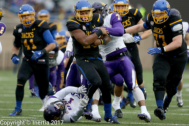 BROOKINGS, SD - OCTOBER 14: Mikey Daniel #26 from South Dakota State University surges past Rickey Neal #7 and Elijah Campbell #1 from Northern Iowa in the first half of their game Saturday afternoon at Dana J. Dykhouse Stadium in Brookings, SD. (Photo by Dave Eggen/Inertia)