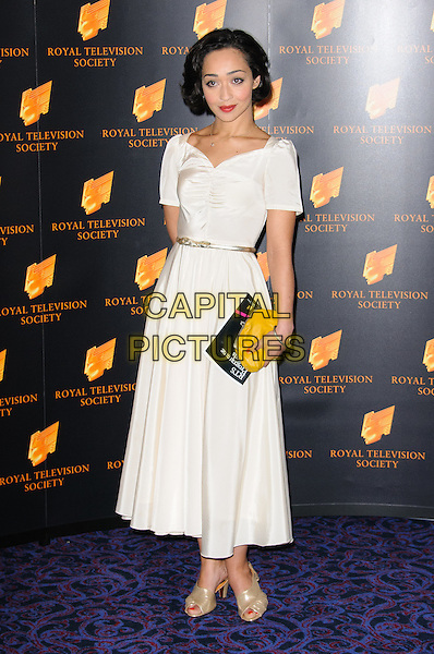 Ruth Negga.Arrivals at the RTS Programme Awards 2012, London, England..March 20th, 2012.full length dress white hand on hip yellow clutch bag.CAP/CJ.©Chris Joseph/Capital Pictures.