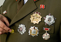 A portrait of Alejandro Cao de Benos, photographed in the village of Salomo in northeast Spain showing the medals on his uniform. As a Korean-Spanish communist, Alejandro is the president of the Korean Friendship Association (KFA) and has been an advocate of the Democratic People's Republic of Korea (North Korea) since 1990. His Korean name is Zo Sun-il (Korea is One) and he works as an honorary Special Delegate of the DPRK's Committee for Cultural Relations with Foreign Countries - a North Korean government spokesman in Europe.