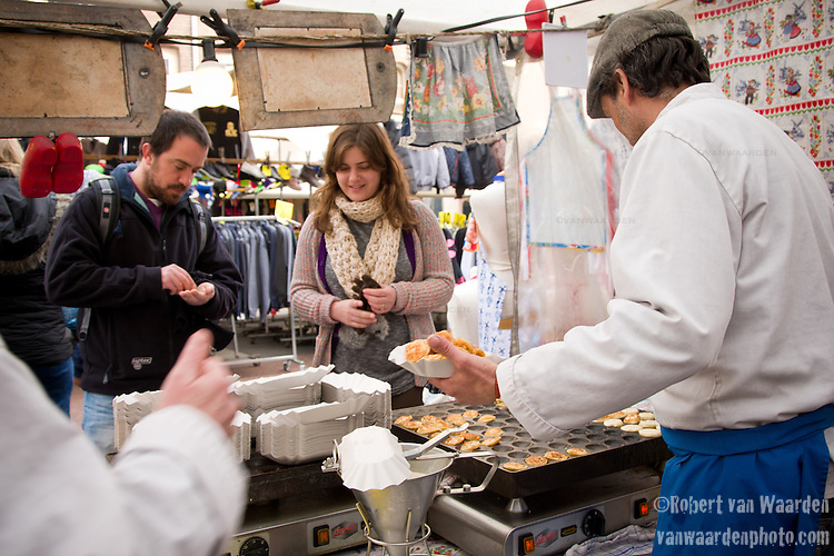Selling Poffertjes, small dutch pancakes, on the Albert Cuyp Market in Amsterdam.