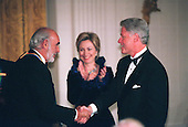 1999 Kennedy Center Honoree Sean Connery is congratulated by United States President Bill Clinton and first lady Hillary Rodham Clinton at a White House reception in Washington, D.C. on December 5, 1999..Credit:Robert Trippett - Pool / CNP