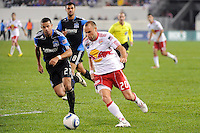 Joel Lindpere (20) of the New York Red Bulls is marked by Jason Hernandez (21) of the San Jose Earthquakes. The San Jose Earthquakes defeated the New York Red Bulls 3-1, (3-2) on aggregate during the 2nd leg of the Major League Soccer (MLS) Eastern Conference Semifinals at Red Bull Arena in Harrison, NJ, on November 04, 2010.