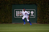Chicago Cubs center fielder Dexter Fowler (24) settles under a fly ball in the sixth inning during Game 4 of the Major League Baseball World Series against the Cleveland Indians on October 29, 2016 at Wrigley Field in Chicago, Illinois.  (Mike Janes/Four Seam Images)