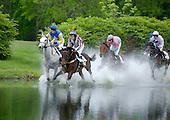 Swimming River, right, and Battle Op lead the charge through the water in the Steeplethon.