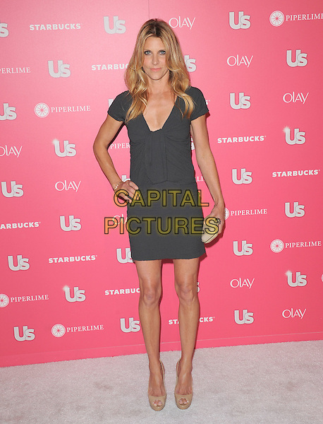 JILLIAN DEMPSEY .at US Weekly Hot Hollywood Style Issue Party held at Eden in Hollywood, California, USA, April 26th 2011..full length hand on hip dress skinny thin  grey gray .CAP/RKE/DVS.©DVS/RockinExposures/Capital Pictures.