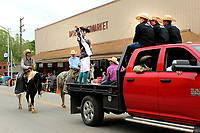 MEGAN DAVIS/MCDONALD COUNTY PRESS A rodeo clown with TK Rodeo shows his trick roping skills while standing in the bed of a trailer during the Old Timer's Day parade.