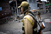 Soldiers from the paramilitary force, Central Reserve Police Force (CRPF) are seen patrolling the streets on empty streets in the downtown area of Nowhatta, Srinagar, summer capital of Jammu and Kashmir, India. A 50 hour curfew was imposed on May 5th to boycott the elections on May 7, 2009. ..Kashmir went into polls on the 4th round of Indian general elections. About 26 percent polling was recorded in the Indian parliamentary elections held in Kashmir on Thursday, May 7th 2009. The poll percentage was on the higher side this year as compared to 2004 polls when 15.04 percent polling was recorded.