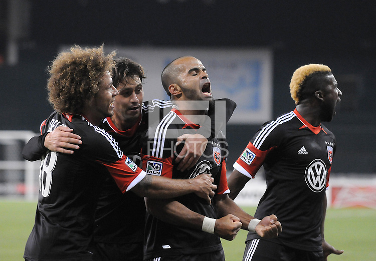 D.C. United forward Maicon Santos (29) celebrates with teammates Nick DeLeon (18) and Branko Boskovic (8) and Brandon McDonald (4) his second goal of the game in the 73th minute of the game. D.C. United defeated FC Dallas 4-1 at RFK Stadium, Friday March 30, 2012.