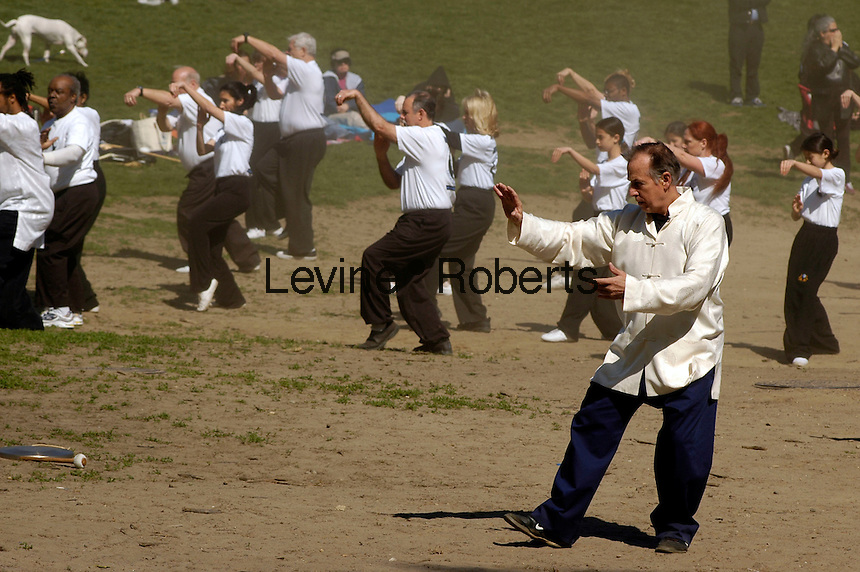 Participants perform their Tai Chi exercises during the World Tai Chi Day event in Central Park in New York City on April 229, 2006. Several hundred people representing Tai Chi groups in the New York area came together to simultaneously perform their exercises regardless of their experience or level. The event was repeated worldwide at exactly 10:00 AM in the respective time zones. (© Richard B. Levine)