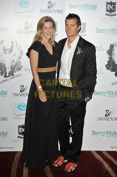 Guest & Bear Grylls.'Global Angels Awards', The Park Plaza Hotel, Westminster, London, England. 2nd December 2011..full length black dress suit gold dragonfly brooch  union jacket slippers shoes loafers red  white shirt .CAP/MAR.© Martin Harris/Capital Pictures.
