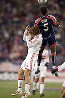 Chicago Fire forward Brian McBride (20) and New England Revolution defender Emmanuel Osei (5) battle for head ball. The New England Revolution tied the Chicago Fire, 0-0, at Gillette Stadium on October 17, 2009.