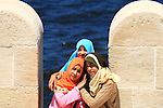 "Young Egyptian girls posed for photo between the loopholes at ""Qaitbey"" fort in Alexandria Egypt"