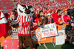 Wisconsin Badgers mascot poses with fans during ESPN College Gameday at Camp Randall Stadium prior to the Wisconsin Badgers NCAA college football game against the Ohio State Buckeyes on October 16, 2010 at Camp Randall Stadium in Madison, Wisconsin.(Photo by David Stluka)