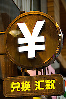 HONG KONG, MAY 08: The Chinese Yuan symbol hangs in front of a currency exchange store, on May 8, 2015, in Hong Kong. (Photo by Lucas Schifres/Pictobank)