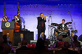 Jazz musician Arturo Sandoval performs during a dinner for Medal of Freedom awardees at the Smithsonian National Museum of American History on November 20, 2013 in Washington, D.C. <br /> Credit: Kevin Dietsch / Pool via CNP