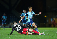 Cian Harries of Coventry City fouls Paris Cowan-Hall of Wycombe Wanderers during the The Checkatrade Trophy Southern Group D match between Wycombe Wanderers and Coventry City at Adams Park, High Wycombe, England on 9 November 2016. Photo by Andy Rowland.