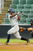 West Virginia Power second baseman Dilson Herrera (31) follows through on his swing against the Kannapolis Intimidators at CMC-Northeast Stadium on July 10, 2013 in Kannapolis, North Carolina.  The Power defeated the Intimidators 4-0.   (Brian Westerholt/Four Seam Images)