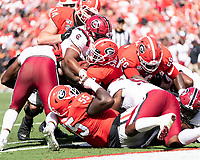 ATHENS, GA - OCTOBER 12: D'Andre Swift #7 of the Georgia Bulldogs scores a running touchdown for Georgia during a game between University of South Carolina Gamecocks and University of Georgia Bulldogs at Sanford Stadium on October 12, 2019 in Athens, Georgia.