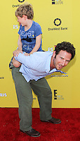 SANTA MONICA, CA, USA - NOVEMBER 16: Mark Feuerstein, Frisco Feuerstein arrives at the P.S. ARTS Express Yourself 2014 held at The Barker Hanger on November 16, 2014 in Santa Monica, California, United States. (Photo by Celebrity Monitor)