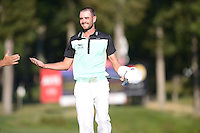 Gainesville, VA - August 2, 2015: Tournament Champion Troy Merritt celebrates after hitting the winning putt on hole 18 of the Quicken Loans National at the Robert Trent Jones Golf Club in Gainesville, VA. August 2, 2015.  (Photo by Philip Peters/Media Images International)