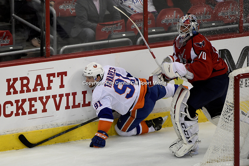 April 23, 2015 - Washington D.C., U.S. - New York Islanders center John Tavares (91) hits the wall behind the net as Washington Capitals goalie Braden Holtby (70) watches the puck during game 5 of the  NHL Eastern Conference Quarter finals between the New York Islanders and the Washington Capitals held at the Verizon Center in Washington DC.  The Capitals defeat the Islanders 5-1 in regulation time to take the lead in the 7 game series 3-2. Eric Canha/CSM