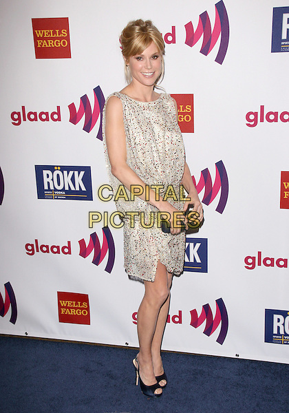 JULIE BOWEN .at The 22nd Annual Glaad Media Awards held at The Westin Bonaventure  in Los Angeles, California, USA, .April 10th 2011..full length sleeveless dress open toe shoes  smiling print  red sequined sequin beaded  white                                                                 .CAP/RKE/DVS.©DVS/RockinExposures/Capital Pictures.