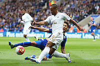 Wayne Routledge of Swansea City is tackled by  Leonardo Ulloa of Leicester City during the Barclays Premier League match between Leicester City and Swansea City played at The King Power Stadium, Leicester on April 24th 2016