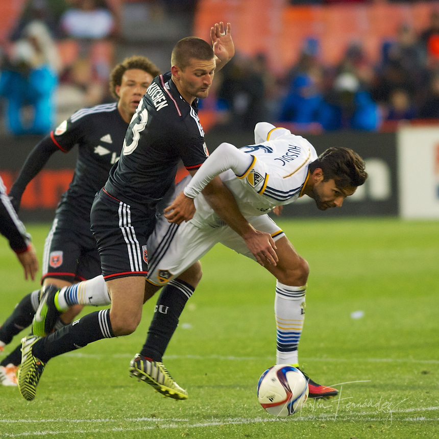 United's Perry Kitchen overruns LA's Baggio Husidic, fouling him in the process. DC United defeated the LA Galaxy 1-0 with a stoppage time goal from Chris Pontius at RFK Stadium in Washington DC.
