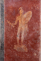 Fresco of the god Mars on a red background, from back wall of the garden area with benches in a summer triclinium beneath a pergola supported by 4 stucco columns, in the Casa dell Efebo, or House of the Ephebus, Pompeii, Italy. This is a large, sumptuously decorated house probably owned by a rich family, and named after the statue of the Ephebus found here. Pompeii is a Roman town which was destroyed and buried under 4-6 m of volcanic ash in the eruption of Mount Vesuvius in 79 AD. Buildings and artefacts were preserved in the ash and have been excavated and restored. Pompeii is listed as a UNESCO World Heritage Site. Picture by Manuel Cohen
