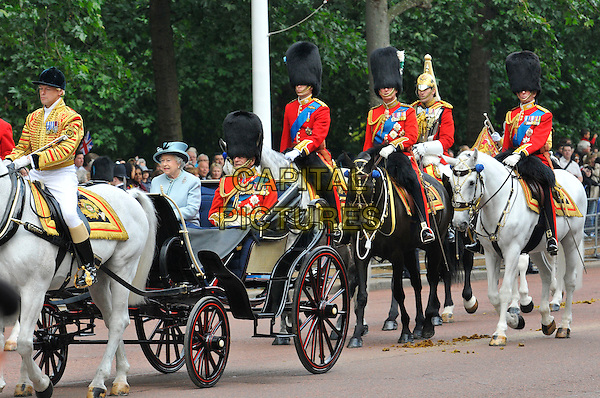 Queen Elizabeth ll and Prince Philip, Duke of Edinburgh.Trooping The Colour - The Queen's official birthday, Horse Guards Parade.London, England..June 11, 2011.royal royalty full length  horses parade march married husband wife uniform.CAP/CAS.©Bob Cass/Capital Pictures.