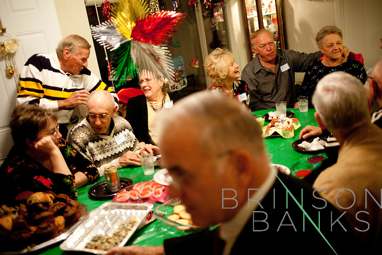 Dozens of Sun City residents fill Norma and Mo Lavoie's Cameo Drive home for a Friday night party December 12, 2009.