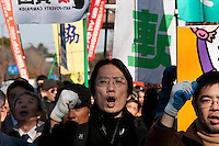 "Makoto Yuasa leads a march to the Japanese government building after the Anti poverty Protest ""Tent Village"" in Hibiya Park in central Tokyo. Japan. Monday January 5th 2009  Organised by the Moyai Foundation, headed by Makoto Yuasa, the event lasted for six days over the New Year`s holiday in 2009 about 1,600 volunteers helped over 500 of Japan`s homeless and unemployed with food, shelter and advice."
