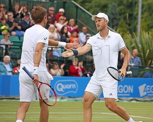 25.06.2016. Nottingham Tennis Centre, Nottingham, England. Aegon Open Mens ATP Tennis. Mens Doubles final. Daniel Nestor of Canada and Dominic Inglot of Great Britain congratulate each other on winning the first set of the doubles final against Marcelo Melo of Brazil and Ivan Dodig of Croatia 7-5