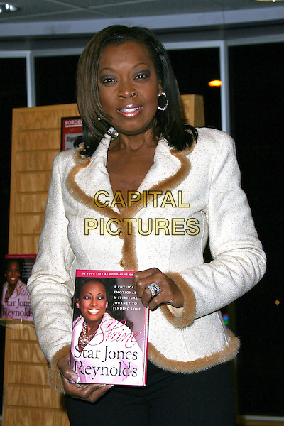 "STAR JONES REYNOLDS.Signing copies of her new book ""Shine"" held at Borders, Westwood, California, USA, .24 February 2006..half length booksigning book-signing holding book.Ref: ADM/ZL.www.capitalpictures.com.sales@capitalpictures.com.©Zach Lipp/AdMedia/Capital Pictures."